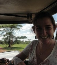 Liza with a giraffe, the pride of Tanzania, in the Serengeti National Park just 3 hours from where she lives