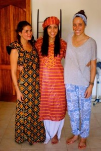 Camille, Lizzie Mulvey and Elise Knutsen at the home of one of their Senegalese co-workers, dressed in their best West African fabrics before celebrating the Muslim holiday of Tabaski.