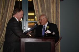 PiAf Board President Jim Robinson presenting PiAf Medal to Barry Segal