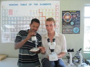 Thomas showing one of his students, Yasin, how not to use the microscopes.