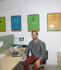 Jon at his desk at the Olam office.