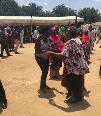 Faith dancing with a member of the Kibaha intergenerational project as part of an exercise break during the learning festival - March 2017